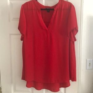 Red blouse with v neck line
